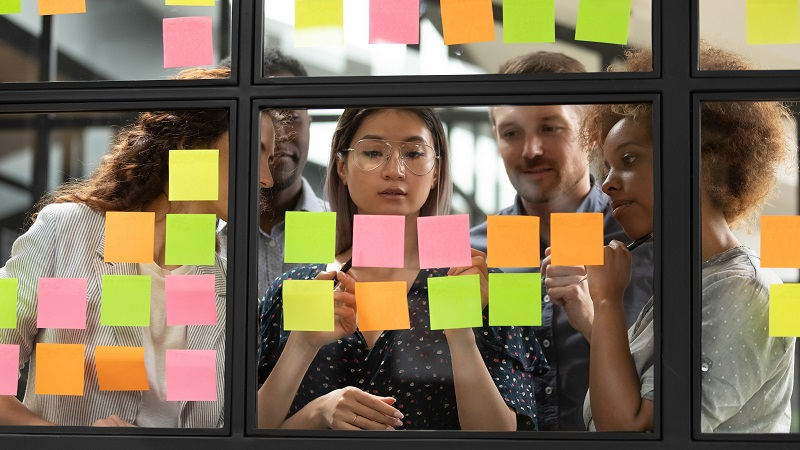 Diverse employees using post-its