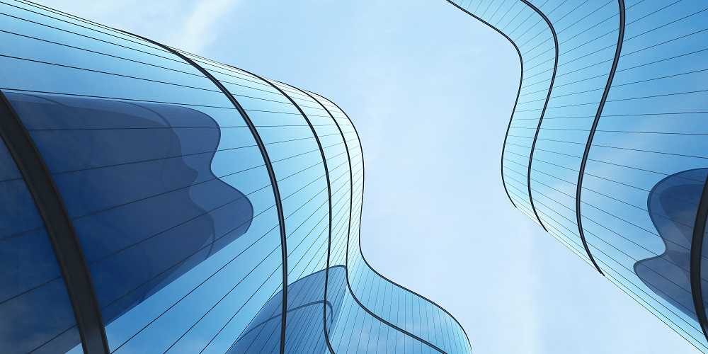 Upward view of curved glass buildings