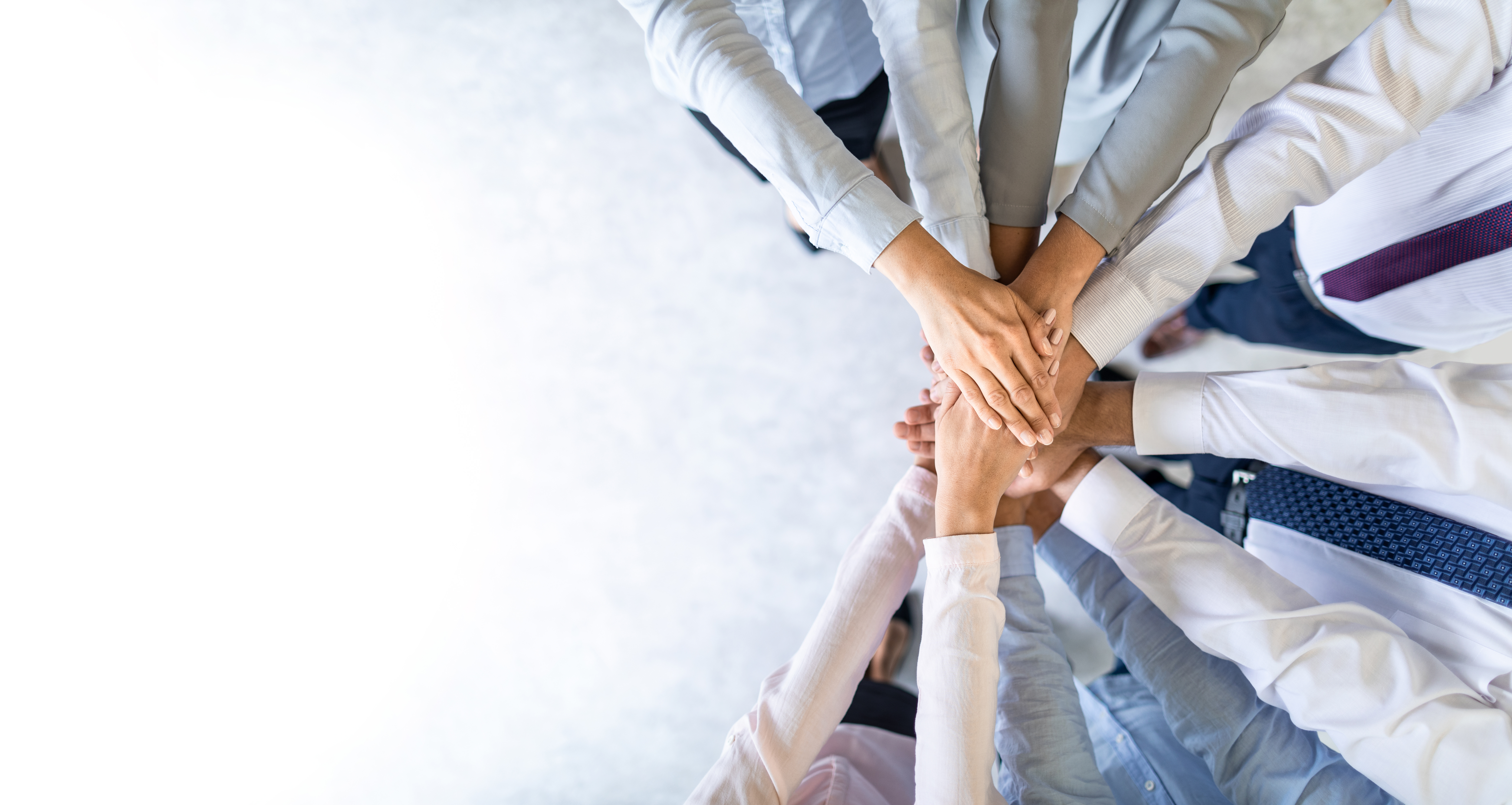 Hands put together in a circle for teamwork
